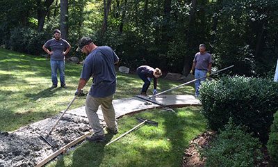 DN Tanks volunteers pouring concrete for wheel chair accessibility