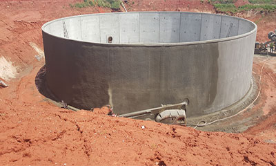shotcrete operations on open top flow equalization basin tank in Oklahoma City, OK