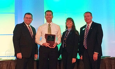 DN Tanks' Engineering Manager, Tom Bloomer accepts section chair award from AWWA CA-NV section